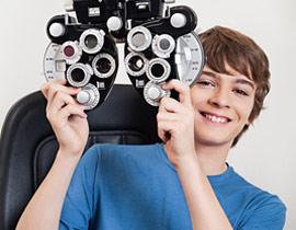 Accent Eye Care boy-smiles-phoropter-270x210