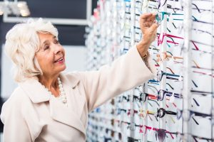 Accent Eye Care Lady looking for glasses