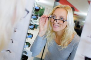 Accent Eye Care woman-try-on-glasses-for-good-vision-PTR4Z8R