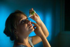 Accent Eye Care woman-with-eyes-tired-applying-collyrium-eye-PUTJKLB