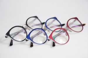 Accent Eye Care multicolored-glasses-on-the-white-background-PHAD8XB
