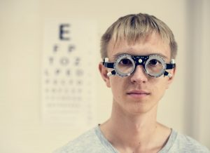 Accent Eye Care young-man-is-having-sight-testing-PLU3N92